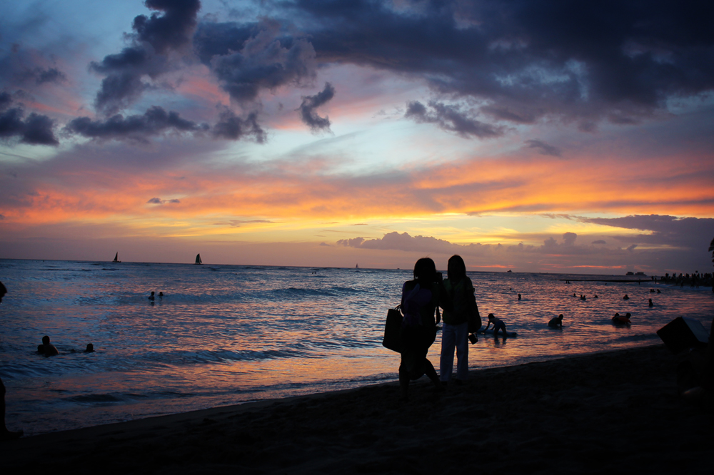 Taking in Waikiki's sunset in Hawaii on the eve of flying to Sydney for the first time